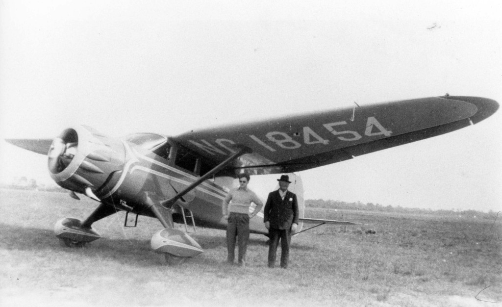 "Dr. Fred Albee and his pilot nephew, Stephen Albee, Jr., under the wing of Dr. Albee's airplane ambulance ""The Reliance"" (Stinson Reliant Airplane). The plane was used for long distance flights transporting patients to his Florida Medical Center located in what was the former Parkview Hotel (where the Venice Post Office is now located). Dr. Albee purchased the hotel from the BLE during the depression. c. 1930s (0124)"